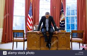 desk in oval office. PRESIDENT BARACK On His Desk In The Oval Office Before A Conference Call With European Leaders 23 February 2016. Photo: Pete Souza/White House