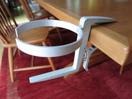 the cupholder loop is also spring loaded simply pull it from the and twist it ninety degrees into position the quick and secure setup is the clever