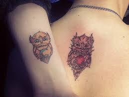 татуировка на двоих на предплечье и спине у парня и девушки сова