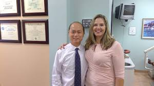 cosmetic dentistry dr ma in a photos with one of his staff members who assists with cosmetic