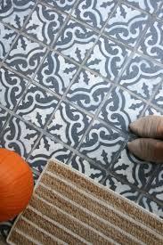i painted faux encaustic cement tile on my front porch