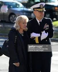 Patty Carpenter stands with U.S. Navy Rear Admiral Thomas Bond as the...  News Photo - Getty Images