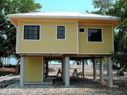 small beach house plans small elevated beach house plans with pilings farmhouse design small beach house