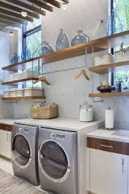7 Laundry Room Design Ideas To Incorporate Into Your Own Laundry // A  hanging bar
