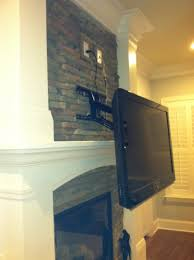 mounting fireplace photo mount tv above into brick hiding wires without studs