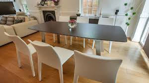 wenge wood extending dining table and white stackable chairs