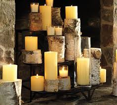 casasugar logs and candles make romantic display in off season fireplace