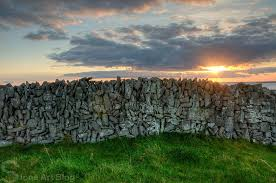 stacked stone wall on stone wall artist with the art of the dry stack stone wall insteading