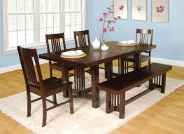 here s a very solid dining set with bench table can be extended with a center