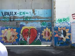 one of the most famous graffiti artists around the world and with art in the west bank is an artist named banksy banksy exact identity is unknown but he is  on most famous wall artist with the power of art mejdi tours