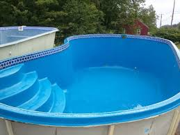 Awesome Kidney Shaped Above Ground Pool in Blue Hues Exterior