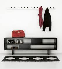 furniture white wall mounted coat racks with black hook on the wall connected by black