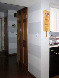 Gray and white striped hallway wood doors and bi color black and