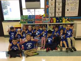 first grade students proudly wearing new bulldog t shirts