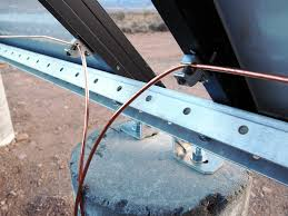 kb ranch  brad close up of grounding lugs attached to the solar panels