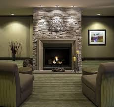 grey stone fireplace modern look stripes sofa lamps