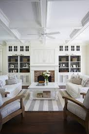 fireplace with whitewashed red brick surround and white mantel