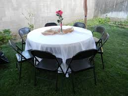 white table linen with chairs and center piece