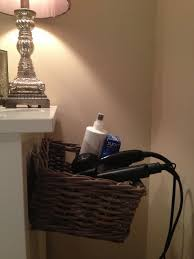organize hair dryer on side of dresser use 3m hooks and a basket to build