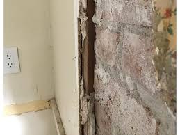 where the brick chimney meets drywall