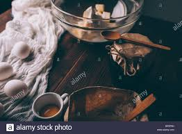 Close Up Of Rustic Kitchen Table With Ingredients And Utensils For