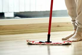 homemade floor cleaner recipe a person and a mop standing on a shiny clean floor