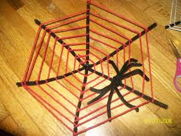 Made these cute spider webs and spiders on a whim with the hubby and kidos.  You take 3 to 4 pipe cleaners and make the