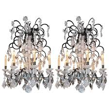 pair of modern rock crystal chandliers for