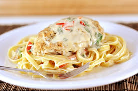 olive garden tuscan garlic chicken. Plain Tuscan Olive Garden Tuscan Garlic Chicken Recipe Is For You A Plate Full Of  Cooked Fettuccine Noodles With A Breaded Chicken Breast White Sauce Intended P