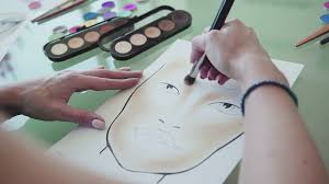 make up artist creates a make up sketch on the face chart inspiration make up artist draws face lines on watercolor paper using professional cosmetics
