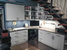 office storage room. perfect office home office and man cave created from space under the basement stairs inside office storage room