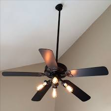 for cody s room quick ceiling fan makeover simply remove the shades and s and use edison bulbs for a more modern look