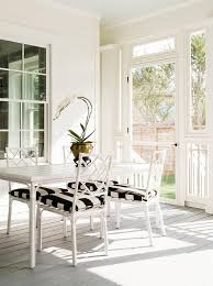 white bamboo dining chairs with black