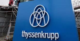 thyssenkrupp elevator logo. the thyssenkrupp logo and wordmark in front of a german elevator testing tower thyssenkrupp w