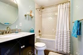 aqua bathroom tile. aqua bathroom with dark floor and tile wall trim. view of vanity mirror c