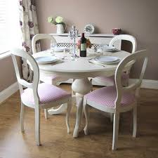 shabby chic round kitchen table and chairs with pink cushion