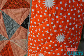 Blog — The Girl Who Quilts & For the backing I chose the Rhoda Ruth wide back Starlight print in flame.  I'm in love with wide back fabric, and this sateen does not disappoint! Adamdwight.com