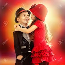 portrait of funny little boy and a cute hugging love concept stock photo 25868276