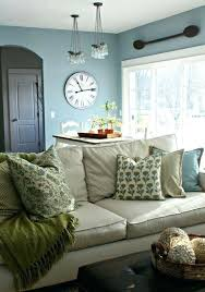 light tan couch light slate blue walls simple decor light tan couch green and blue pillows and throw simple living room decor