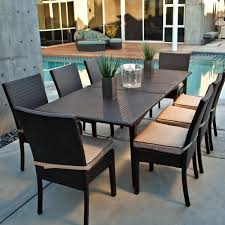 black wicker dining chairs. Furniture. Swimming Pool With Black Wicker Dining Table Set Having Eight Chair Using Beige Padded Seat Placed On Concrete Deck. Chairs