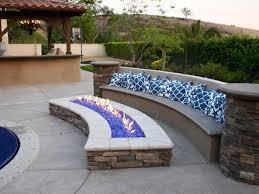 poolside built in bench and fire pit