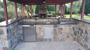 outdoor stonework kitchen with covered area