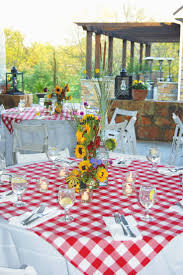 Make red/white checkered tablecloth overlays placed over white table cloths