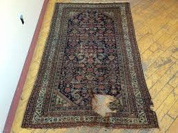 antique little persian rug probably farrahan with charming human figures pretty apple green corners