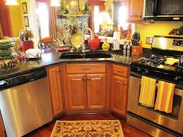 cute rooster kitchen decor and wooden kitchen island with laminate wood floor