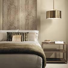 Faux wood wallpaper as a headboard. Wooden wall look.