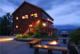 one of the great cabins in gatliburg and pigeon forge with an outdoor firepit