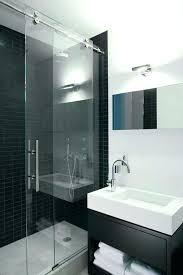 aquaglass shower barn door shower door aqua glass shower door contemporary bathroom and black shower tile