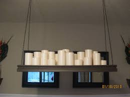 i put rested some of the candles on ss of leftover trim to stagger the heights of the glasses there are only two diffe sizes here