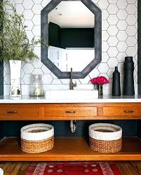black hexagon tile bathroom white hex tiles on the walls with black grout and a black